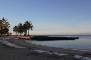 Hawaii at sunrise, beach near resort